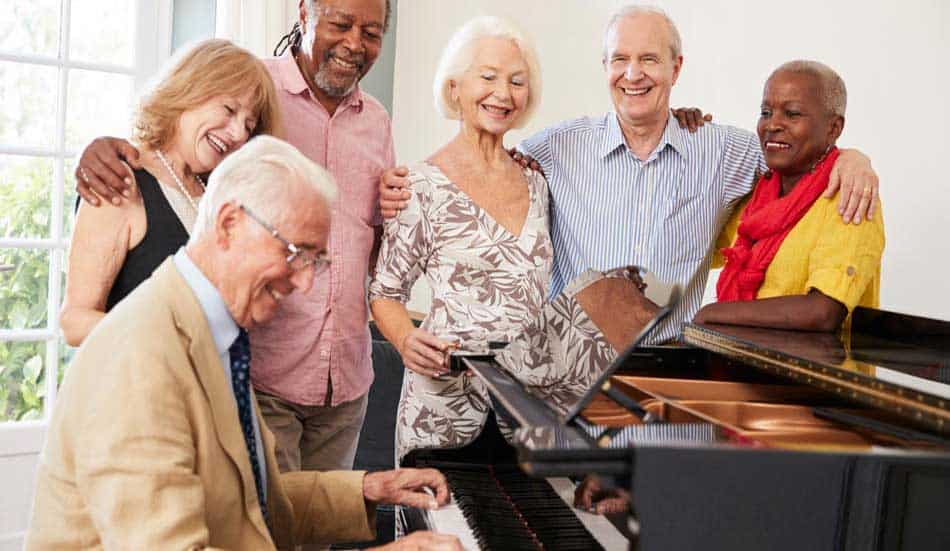 group around piano quail assisted living
