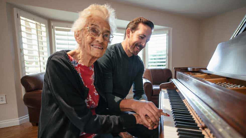 Justin playing the piano with resident